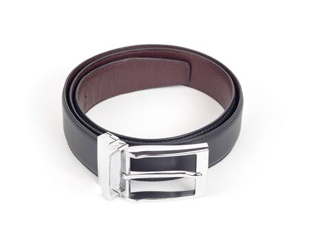 bilateral: bilateral black and brown leather belt on white background Stock Photo
