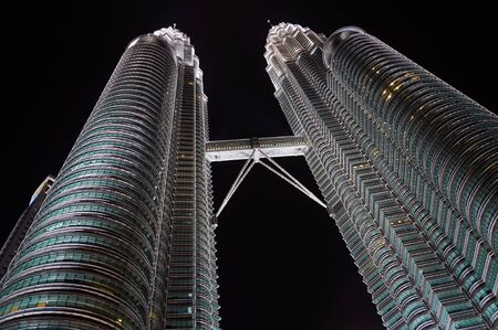 tallest bridge: KUALA LUMPUR, MALAYSIA - NOVEMBER 14, 2010: The Petronas Twin Towers on November 14, 2010, in Kuala Lumpur, Malaysia. One of the words highest buildings. Two towers are connected by Sky Bridge Editorial