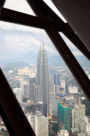 petronas: KUALA LUMPUR, MALAYSIA - NOVEMBER 17, 2010: downtown area of Kuala Lumpur with Petronas Twin Towers on November 17, 2010, , Malaysia. View from Kuala Lumpur Tower