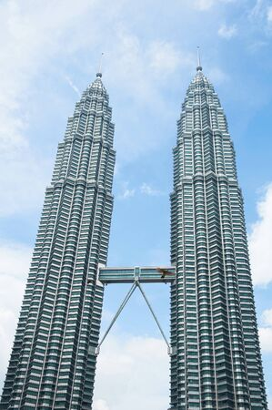 petronas: KUALA LUMPUR, MALAYSIA - NOVEMBER 17, 2010: The Petronas Twin Towers on November 17, 2010, in Kuala Lumpur, Malaysia. One of the words highest buildings. Day view
