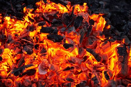 smoldering: Smoldering charcoal. It is bright and hot. Stock Photo