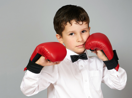 five years old: Five years old boy in white shirt and bow tie with boxingkarate gloves on the hands