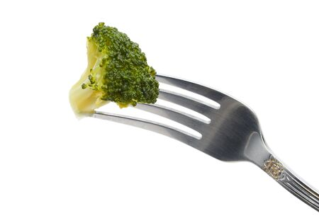Piece of broccoli on a fork isolated over white background