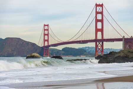 Seeing of famous Golden Gate - suspension bridge connecting San Francisco Bay and the Pacific Ocean from seashore.