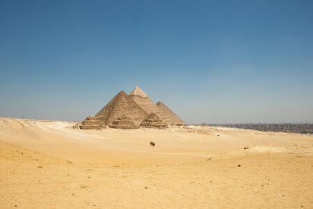 The Giza pyramid complex, also called the Giza Necropolis on the Giza Plateau in Egypt that includes the Great Pyramid of Giza, the Pyramid of Khafre, and the Pyramid of Menkaure, Stock Photo