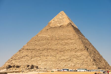 Tourist buses near Pyramid of Khafre (also read as Khafra, Khefren) or of Chephren, the second-tallest and second-largest of the Ancient Egyptian Pyramids of Giza and the tomb of the Fourth-Dynasty pharaoh Khafre (Chefren)