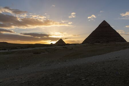The Sun is going down behind the Pyramid of Menkaure Stock Photo