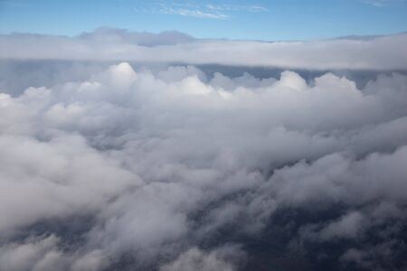 Cloudcape made from window of airplane above clouds