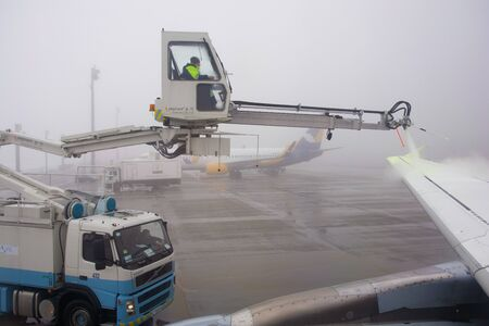 Boryspil, Kyiv / Ukraine - Feb 1st 2019 - Airplane is being prepared for flight. The wing is sprayed by special liquid to prevent icing in Kyiv international airport Boryspil (KBP) on the 1st February 2019.