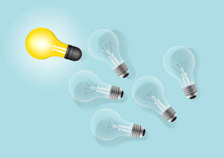 Set of laying light bulbs with one glowing. Light bulb idea creative concept.