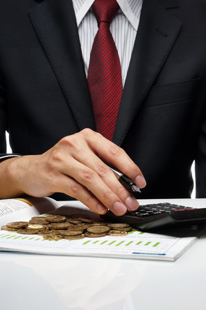 Close-up of businessman doing financial calculation photo