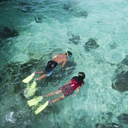 Couple snorkeling with crystal clear water  photo