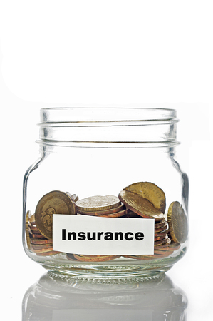 tax tips: Gold coins in jar with Insurance label isolated in white background
