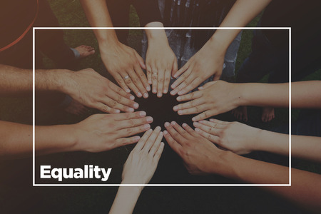 Hands together with text: Equality Stock Photo