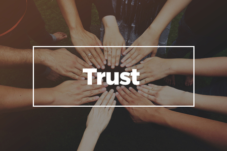 Hands together with text: Trust