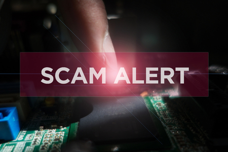 Cyber Security Concept: Close-up of electronic circuit board with Scam Alert Reklamní fotografie
