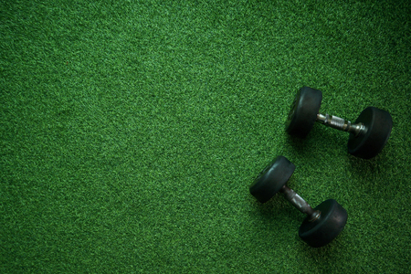 Healthy Concept: Dumbell on green grass