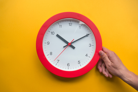 Time management concept over yellow background