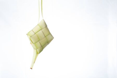 Ketupat (Rice Dumpling) On isolated Background. Ketupat is a natural rice casing made from young coconut leaves for cooking rice during eid Mubarak, Eid ul Fitr