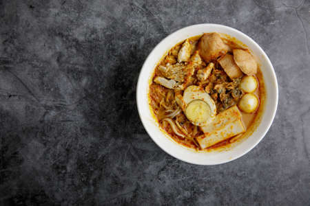 Delicious homemade curry noodles ( mee kari ) serve with seafood and egg