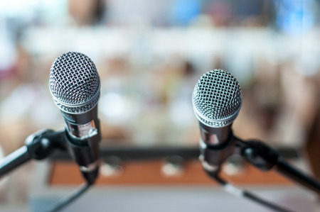 50mm: A shot of two microphones in front of a stage. Stock Photo