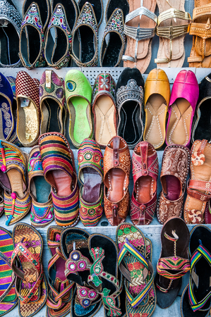 jaipur: A top view shot of colorful handcrafted shoes taken in the streets of Jaipur, India. Stock Photo