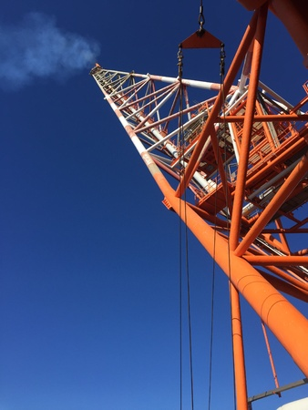 industry: A low angle shot of a flare beam taken at an offshore installation in Libya. Stock Photo