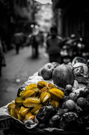 street shot: A selective color shot of star fruits taken at a street market in Old Delhi, India.