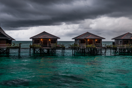 sabah: A shot of water villas in Sabah Malaysia during bad weather.