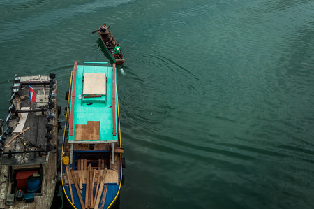 turqoise: A top view shot of fishing boats over turqoise colored water. Stock Photo