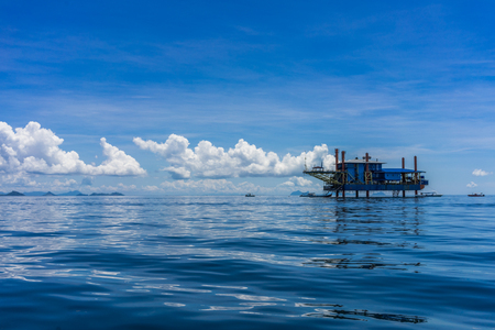 strive for: A shot of abandoned offshore oil rig and now occupied by a scuba diving company. The effect of oil prices has given opportunity for other business to strive. Stock Photo