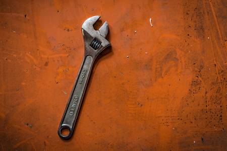 Shah Alam, Selangor Malaysia - May 12, 2016: A shot of an adjustable spanner on orange background. Editorial