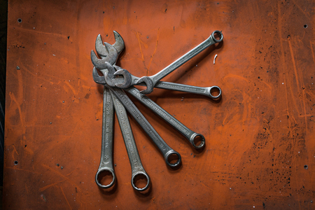 Shah Alam, Selangor Malaysia - May 12, 2016 : A shot of various sizes of wrenches on orange background. Editorial