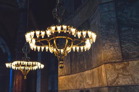 aya sofia: Shot of beautiful chandeliers inside Aya Sofia in Istanbul Turkey
