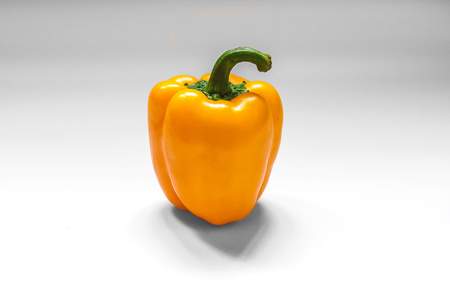 dehydration: A shot of a fresh yellow bell pepper on white background for Dehydration Project Day 1. Stock Photo