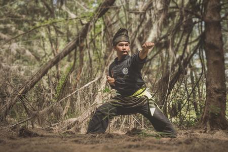 Kampung Mek Mas, Kota Bahru, Kelantan  Malaysia - July 15, 2017 : A shot of a person performing steps of Silat, a kind of martial art practised in South East Asia.