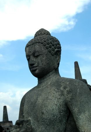 Smiling Budha in Borobudur Temple photo