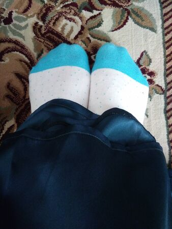 Wearing a pair of blue socks in the Eid morning.