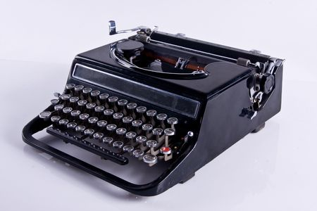 Old black typewriter isolated on white background Stock Photo - 3926113