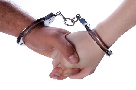 prisoner of love: Man and Woman holding hands in handcuffs