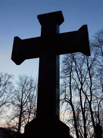 cross silhouette against the sky at sunset photo