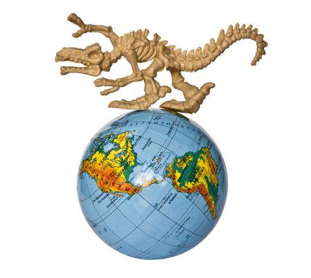 toy dino skeleton prowling around the globe photo
