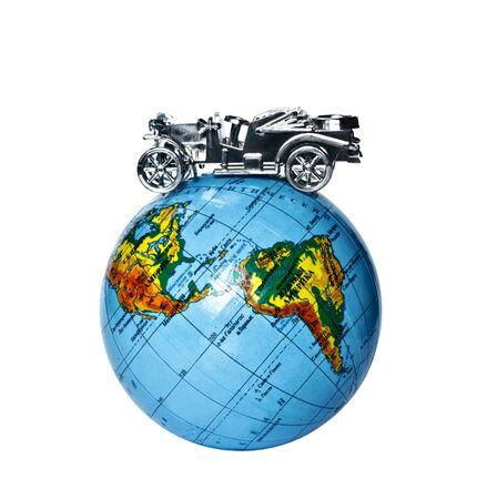 toy retro car on the globe photo