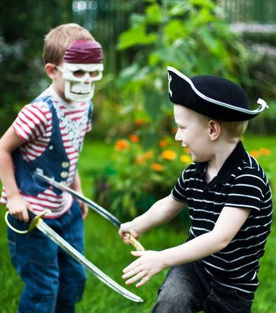 small sword: two brothers wearing pirate costumes and skull mask fighting