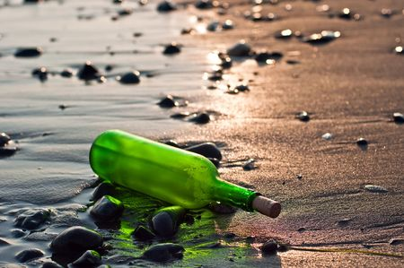 green bottle on the beach at sunset Stock Photo - 5755962