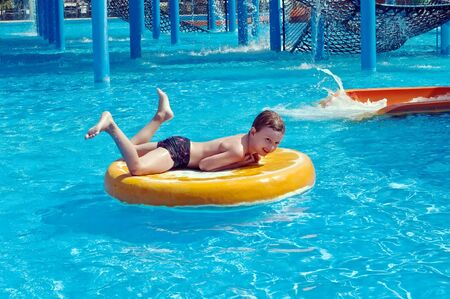 young boy having fun in aquapark, Limassol, Cyprus photo