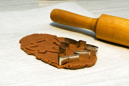 making christmas gingerbread cookies: cutting christmas tree photo