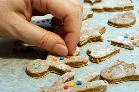 decorating gingerbread man and christmas cookies photo