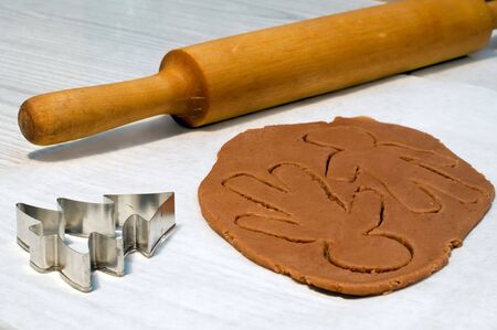 making gingerbread man and christmas cookies photo