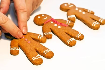 biscuit dough: decorating gingerbread man